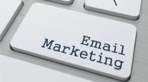 Computer button showing email marketing